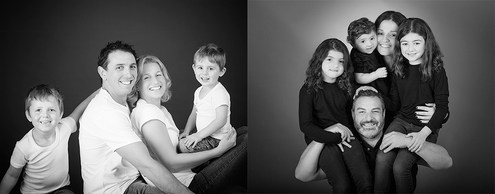 black and white family portrait in the studio with kids laughing